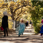 Photo of kids running at zoo in costumes