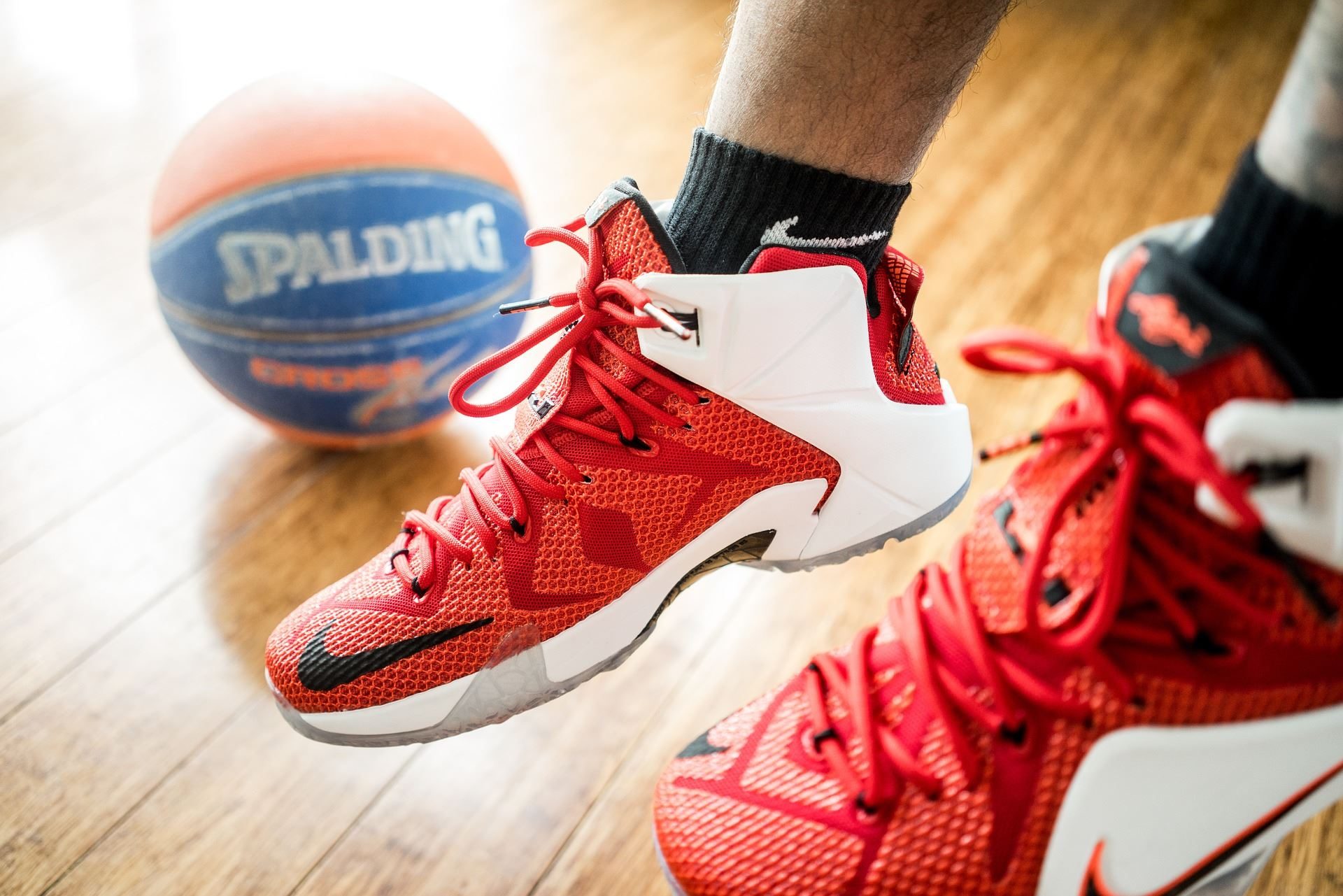 photo of red shoes and a basketball