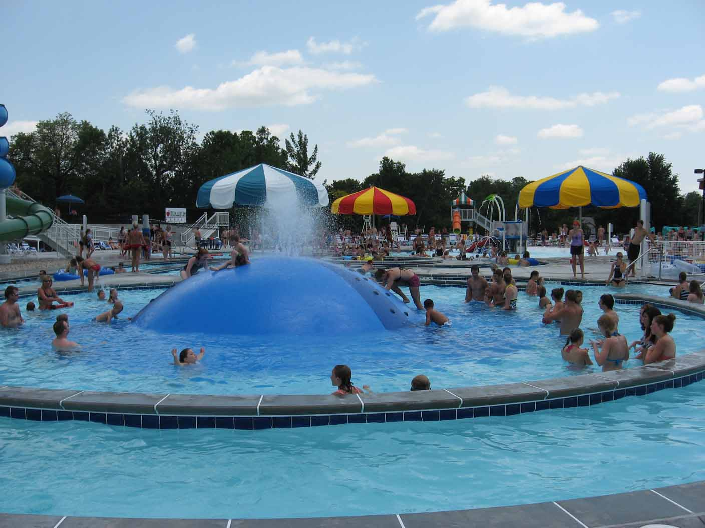 photo of kids and adults playing at City Park Pool