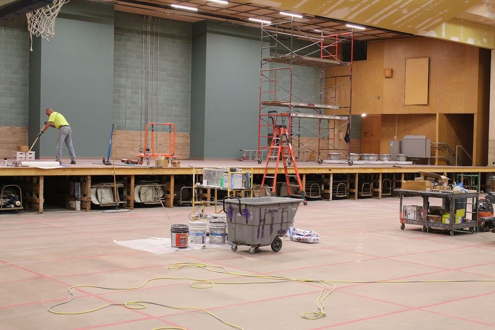 photo of the stage area and flooring during renovation