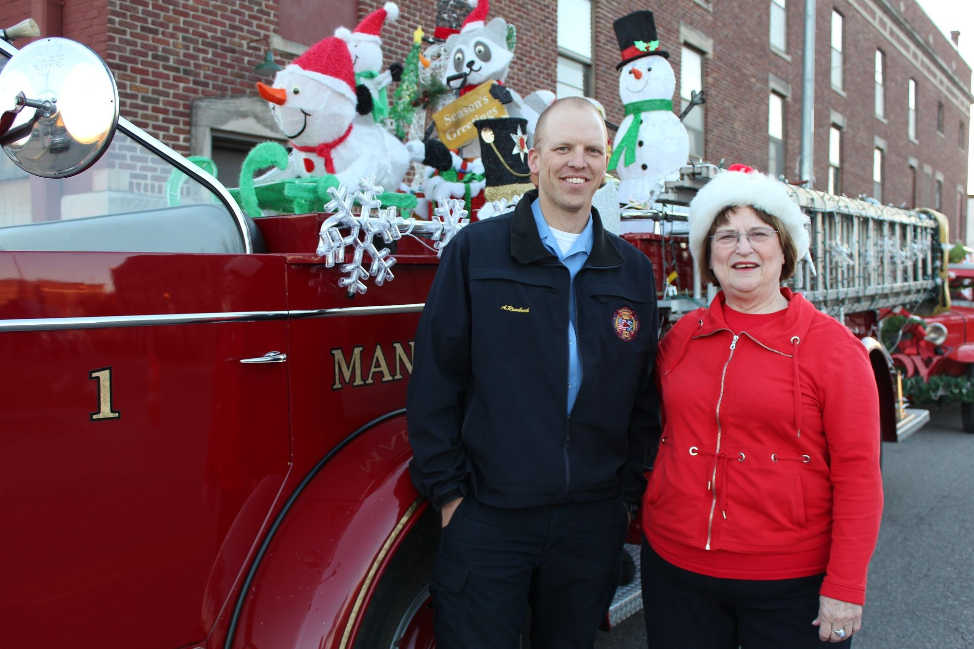 Mayor Morse and A. Rombeck posing in front of Old Fire Engine 1