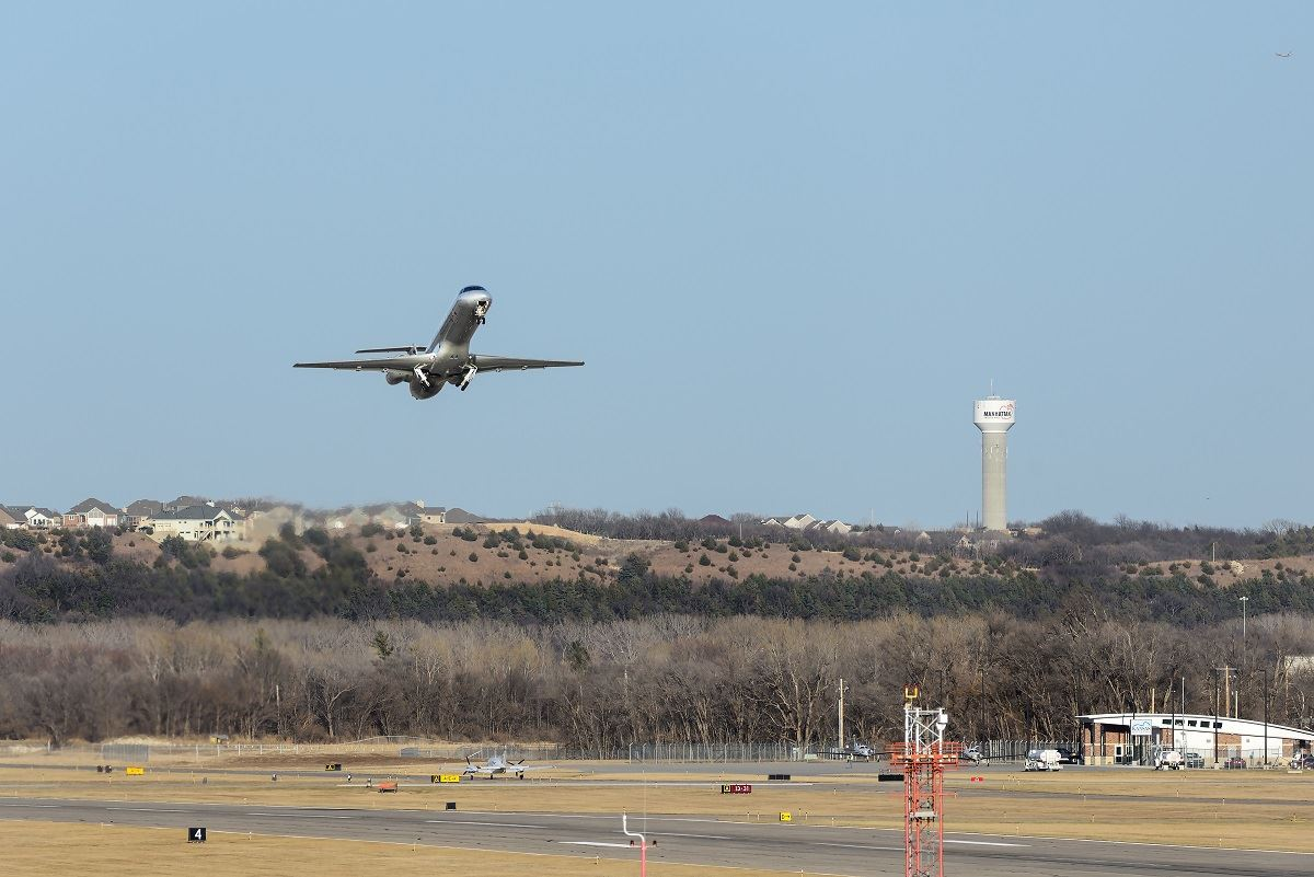 photo of airplane taking off from Manhattan Regional Airport