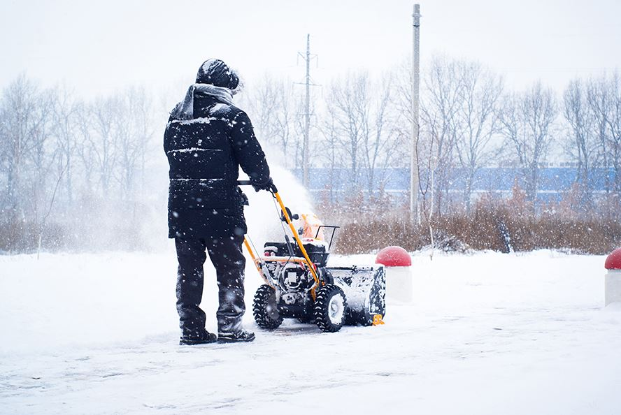 photo of a man clearing snow
