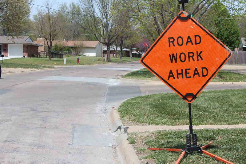 photo of road sign that reads Road Work Ahead