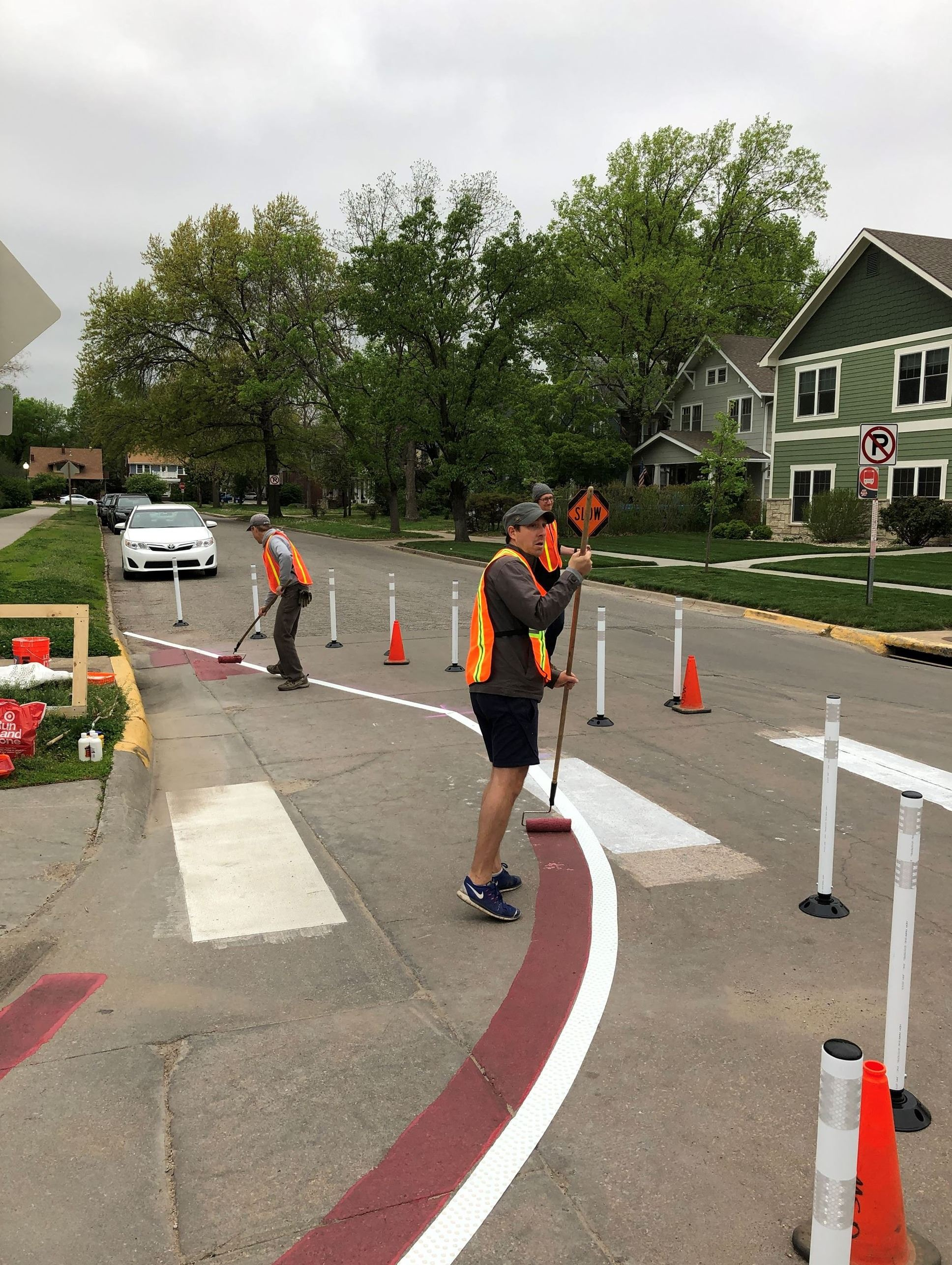 Painting the road to reducing pedestrian crossing distance.