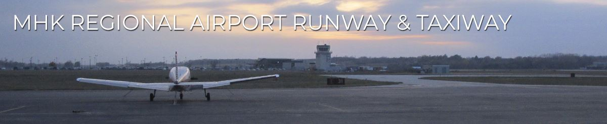 photo of a plane on the runway at Manhattan Regional Airport