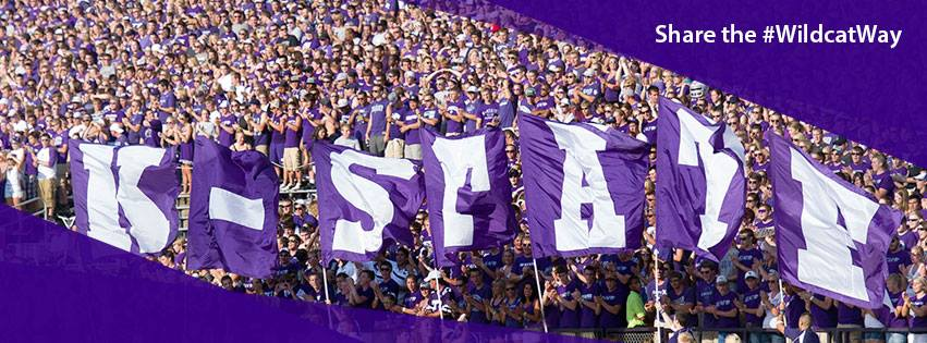 photo of K-State students and a purple K-State banner