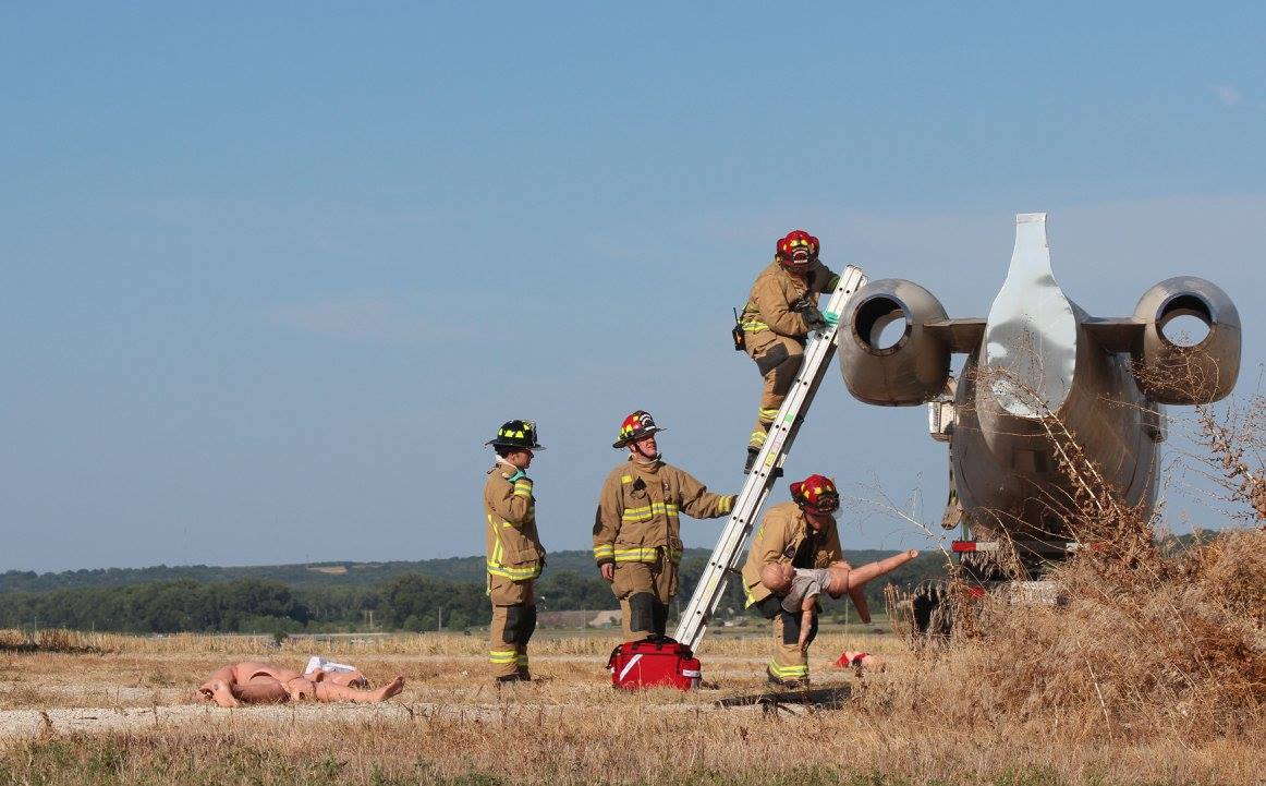 airport full scale exercise - fire crew on fuselage