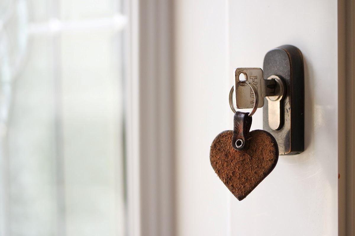 photo of house key hanging from doorknob